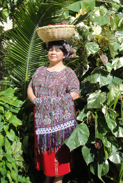 Ixil interpreter and Mayan weaver Sheba Velasco in traditional clothing.
